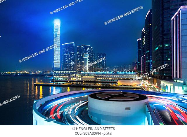 Kowloon business district: skyline with ICC building and cruise terminal at night, Hong Kong, China