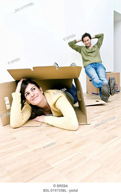 young couple taking break from moving into new home