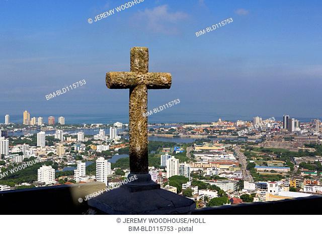 Stone cross overlooking Cartagena skyline, Cartagena, Colombia