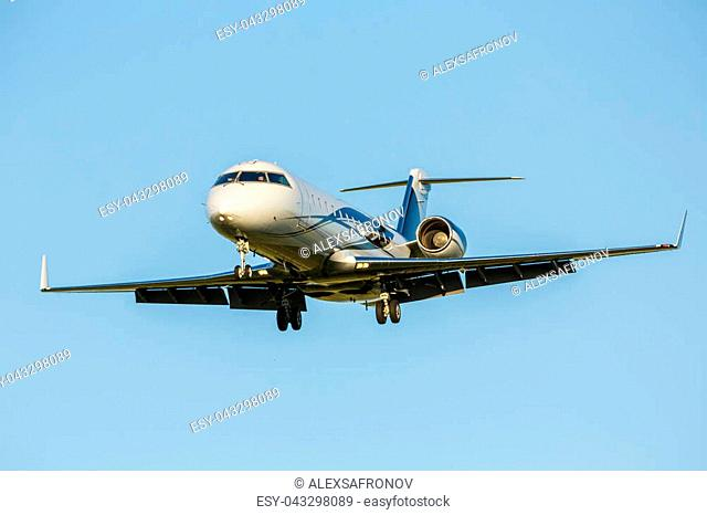 Large passenger Airplane flying in blue sky background. Airline Concept Travel Passenger Aircraft