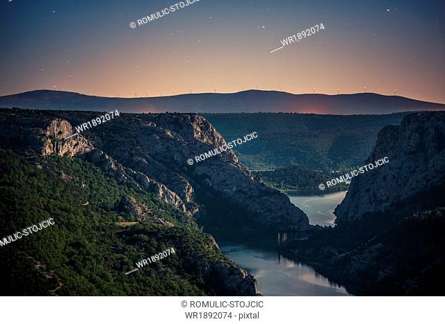 Mountain range with river under starry sky, Krka National Park, Croatia