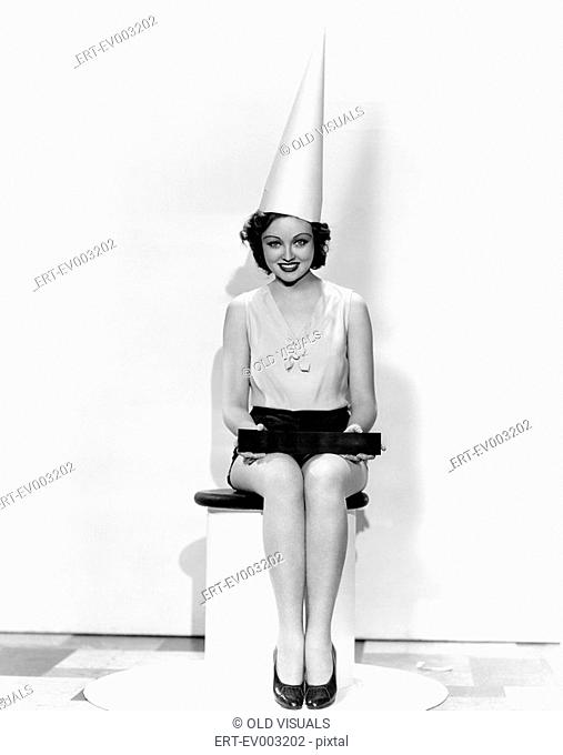 Portrait of woman with April Fool sign wearing dunce cap All persons depicted are not longer living and no estate exists Supplier warranties that there will be...