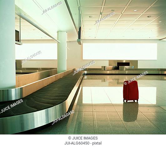 Suitcase near luggage carousel