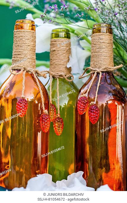Colorful wine bottles on a festive table in a garden. Germany