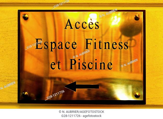 France 35 Brittany Dinard Brass plate indicating in a hotel the acces to fitness space rooms, and indoor swimming pool