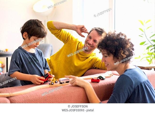 Happy family playing with their kids on a weekend