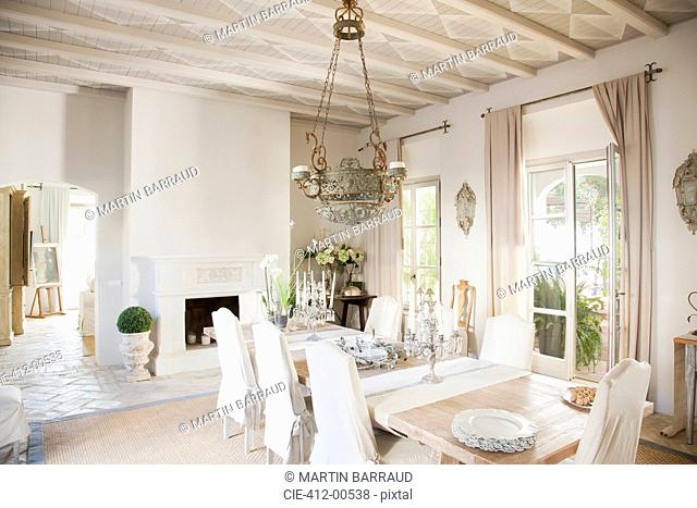 Chandelier over dining table in luxury dining room