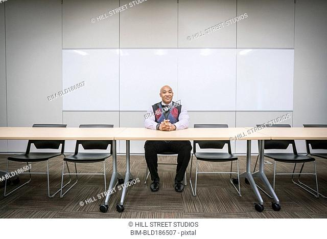 Black businessman sitting at conference table