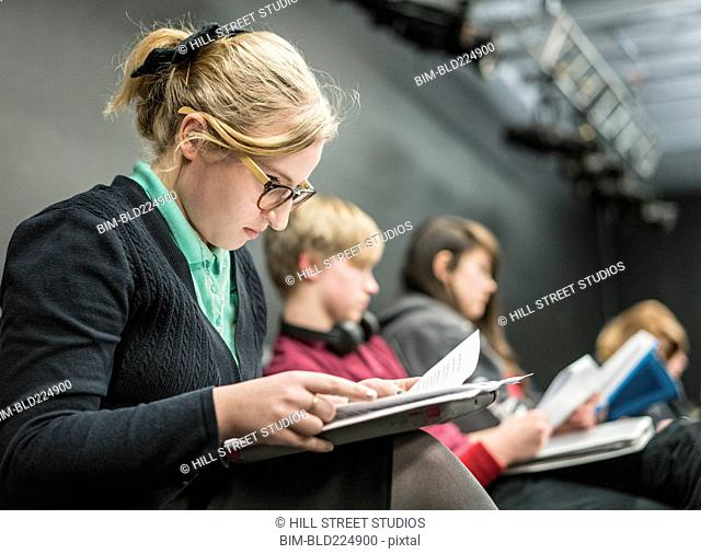 Girl reading script in high school drama class