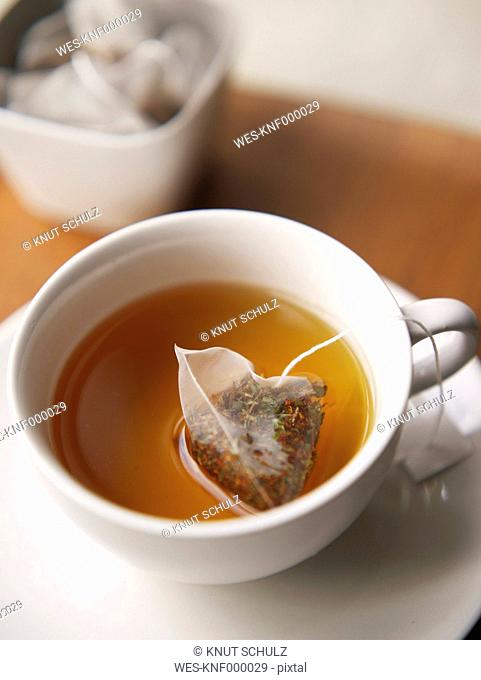 Tea bag in tea cup, close up