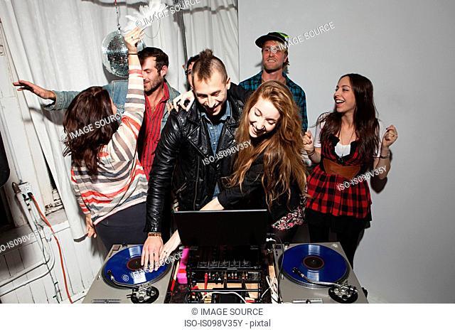 Disc jockeys dancing at party