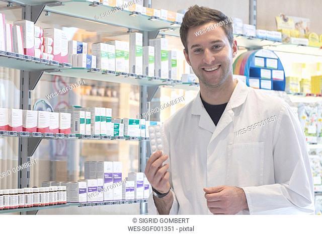 Portrait of smiling pharmacist in pharmacy