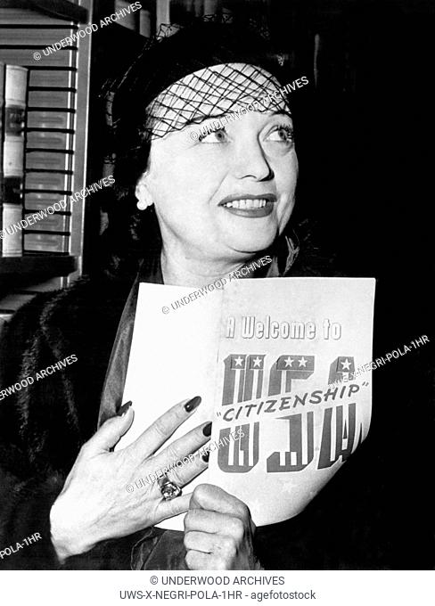 United States: January 12, 1951.Actress Pola Negri of Poland holds her Welcome to USA Citizenship pamphlet as she becomes a U.S. citizen