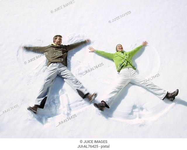 High angle view of a young couple making snow angels