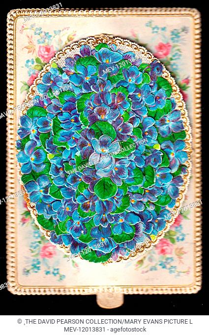 Blue forgetmenots in an oval shape on a greetings card with ornate white and gold border