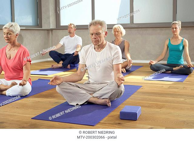 Yoga class senior group meditation relaxing