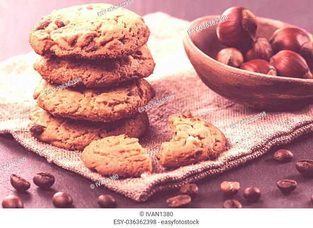 Chocolate chips cookies on black background. Vintage