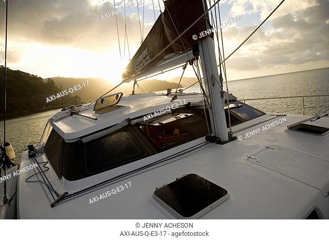 Sailboat at sunset off Whitsunday Islands