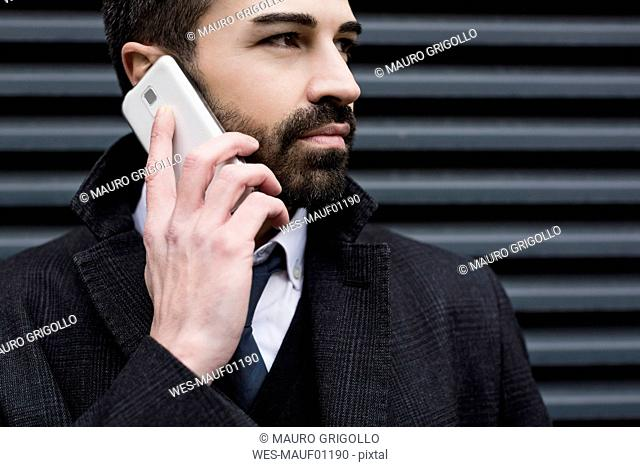 Close-up of businessman on cell phone