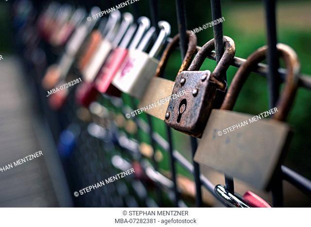 Love locks on a fence, old padlock, rust, patina