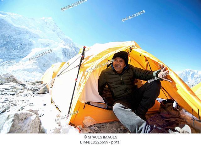 Man sitting in base camp tent, Everest, Khumbu glacier, Nepal