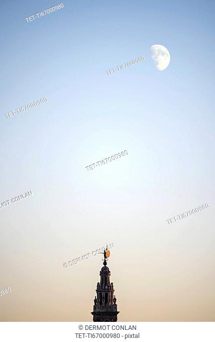 Spain, Andalusia, Seville, Moonrise over Giralda Tower