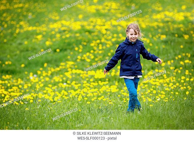 Germany, Baden Wuerttemberg, Girl walking in meadow