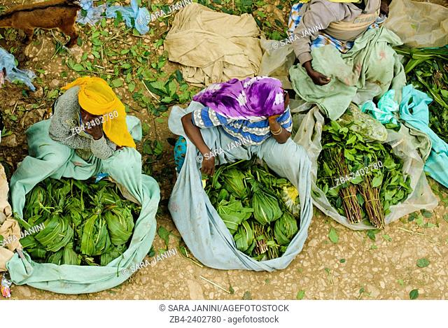 Qat (a narcotic leaf from a fast-growing bush found all over the Horn of Africa and Yemen) sellers at the Christian market outside the medieval walled city of...
