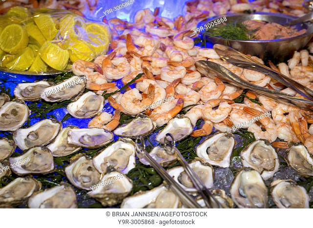 Shrimp and Oyster station at a dinner party buffet, Naples, Florida, USA
