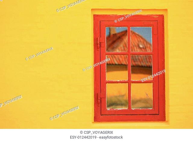 red window on orange wall architecture detail