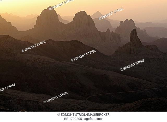 Sunrise view from Assekrem over the volcanic landscape of Atakor, Hoggar, Ahaggar Mountains, Wilaya Tamanrasset, Algeria, Sahara, North Africa