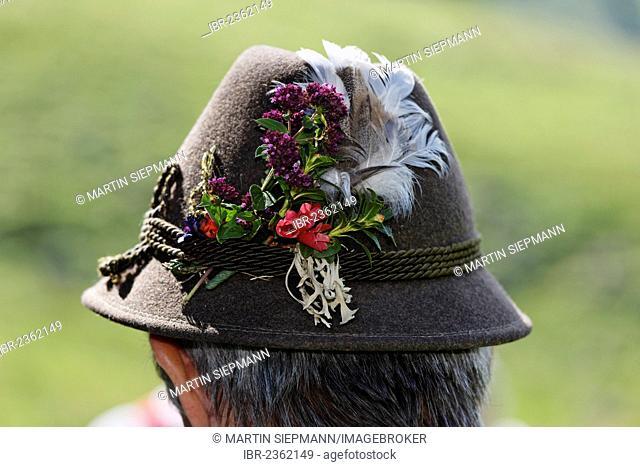 Man wearing a hat decorated with flowers, Pfeifertag festival on Niedergadenalm alp, Strobl, Salzburg state, Salzkammergut resort area, Austria, Europe