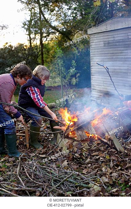 Boys building bonfire outdoors