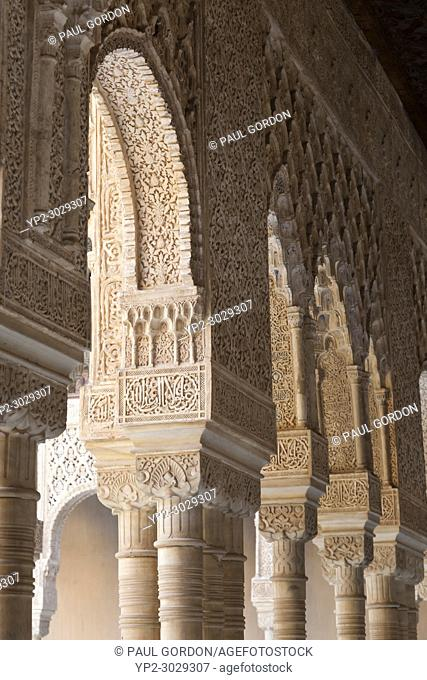 Granada, Spain: The Alhambra Palace and Fortress. Detail of the arcade surrounding the courtyard of the Palacio de los Leones