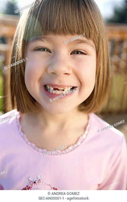 Portrait of girl (4-5) missing teeth