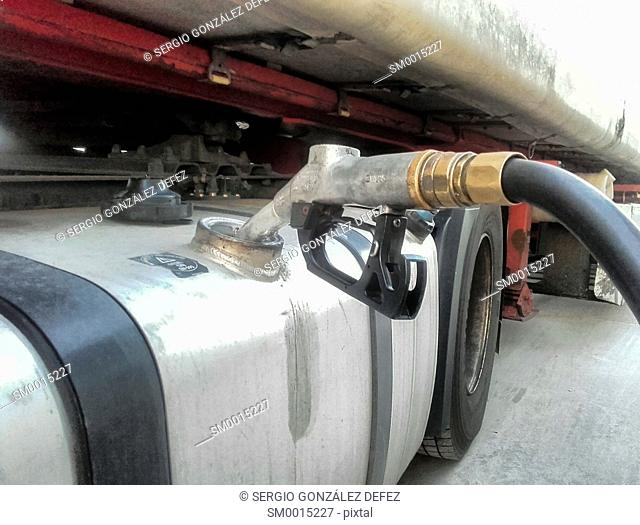 Fuel tank of truck with pump dispenser of gasoline