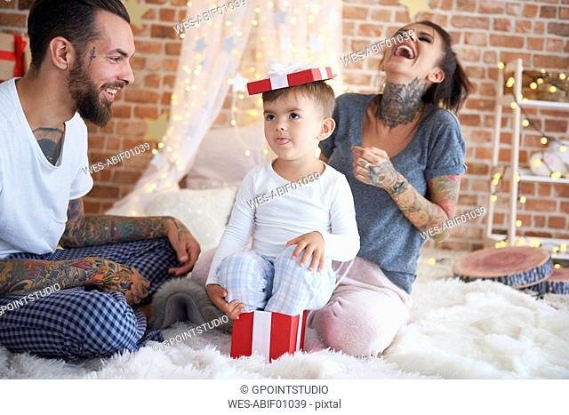 Happy family having fun at Christmas time in bed
