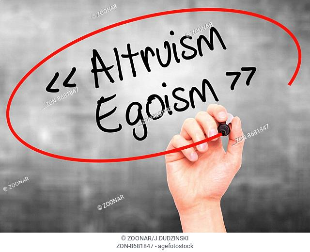 Man Hand writing Altruism - Egoism with black marker on visual screen