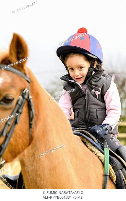 Kid riding on a horse