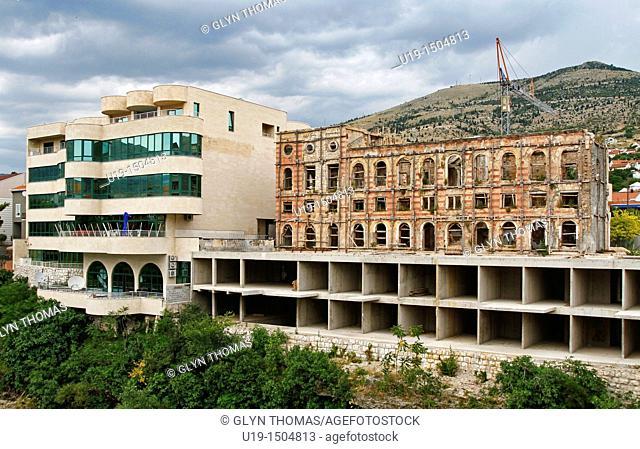 War damaged Hotel Neretva and the new modern hotel, Mostar, Bosnia and Herzegovina