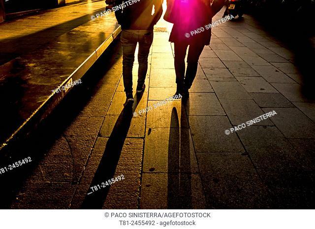 People walk at sunset, Barcelona