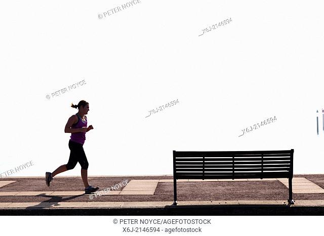 Woman jogger on Southsea Promenade