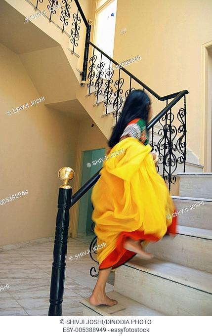 Indian girl climbing stock photos and images age fotostock