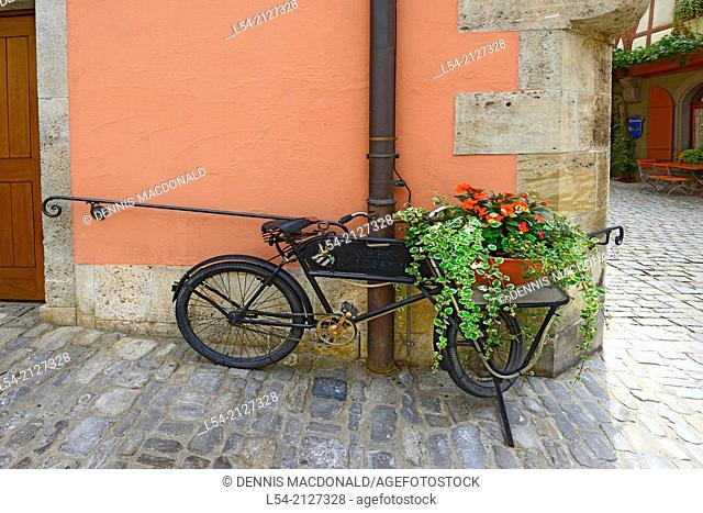 Bicycle with Flowers in basket Rothenburg Germany DE Franconia Bavaria