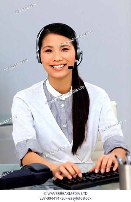 Ethnic customer service representative with headset on