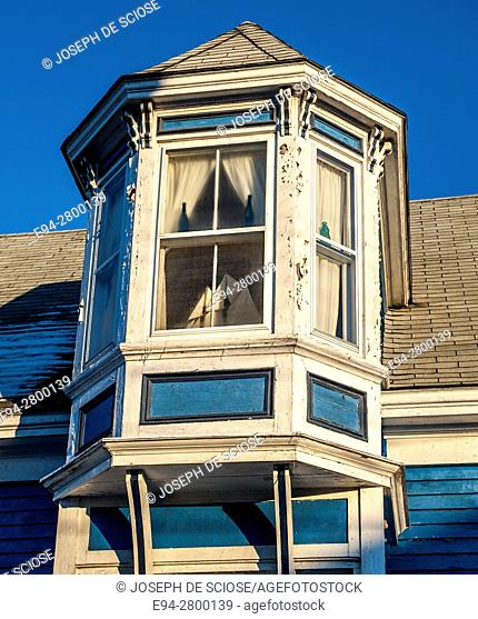 Example of home architecture showing a window detail, in Lunenburg, Nova Scotia, Canada