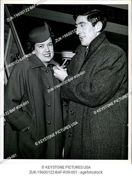 Jan. 22, 1960 - N.Y. International Airport: Star Athlete Ron Delaney, who will make his home in San Francisco, id pictured with TWA hostess Lois Fogle trying to...