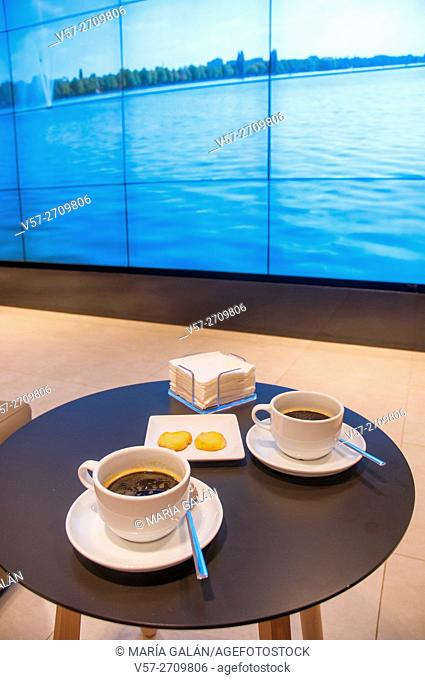 Two cups of coffee and biscuits in a cafeteria