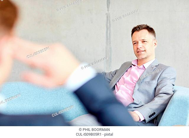 Two businessmen meeting in office