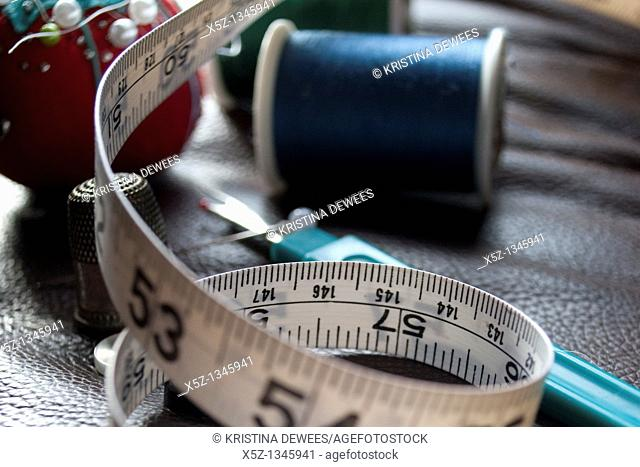 Some measuring tape and assorted sewing box items